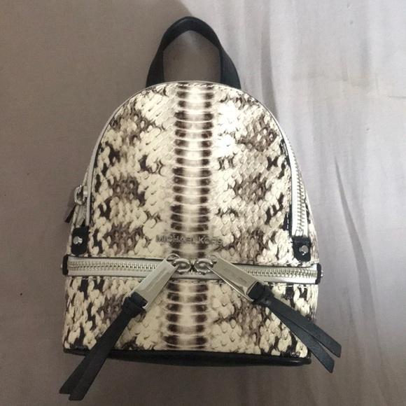 0e978b40d93d86 Michael Kors mini rhea backpack. M_5acd0e5b5521befe0361757d
